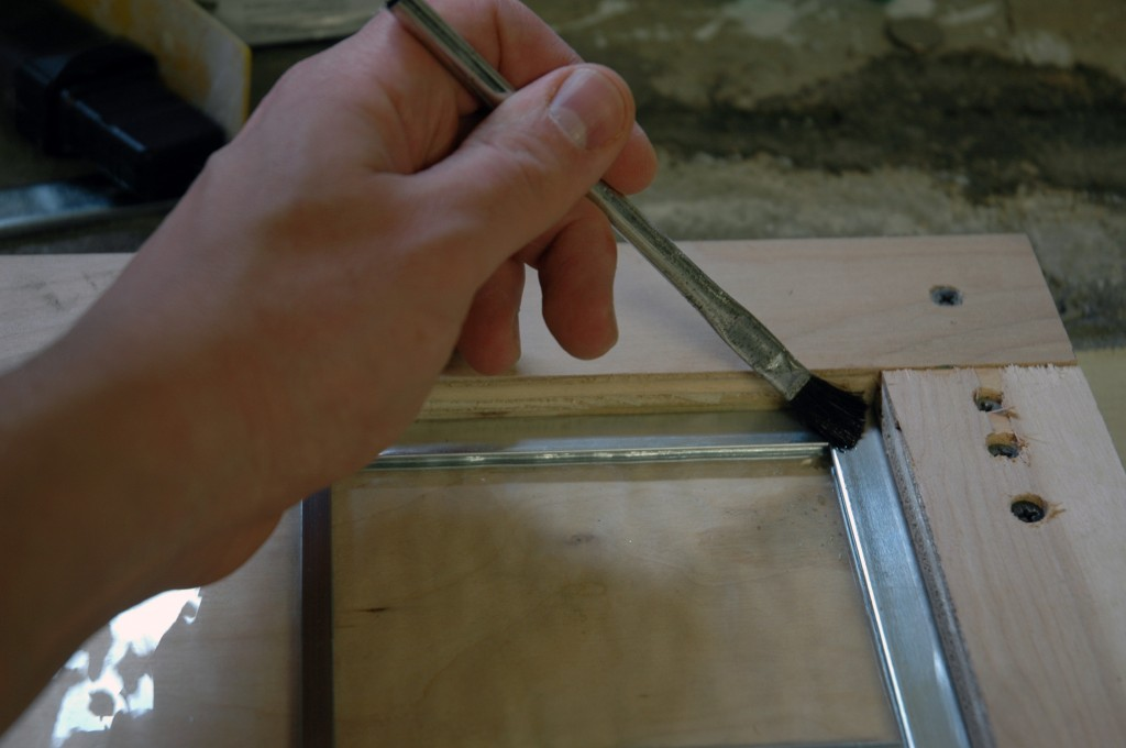 Apply flux to the joints using an acid brush.