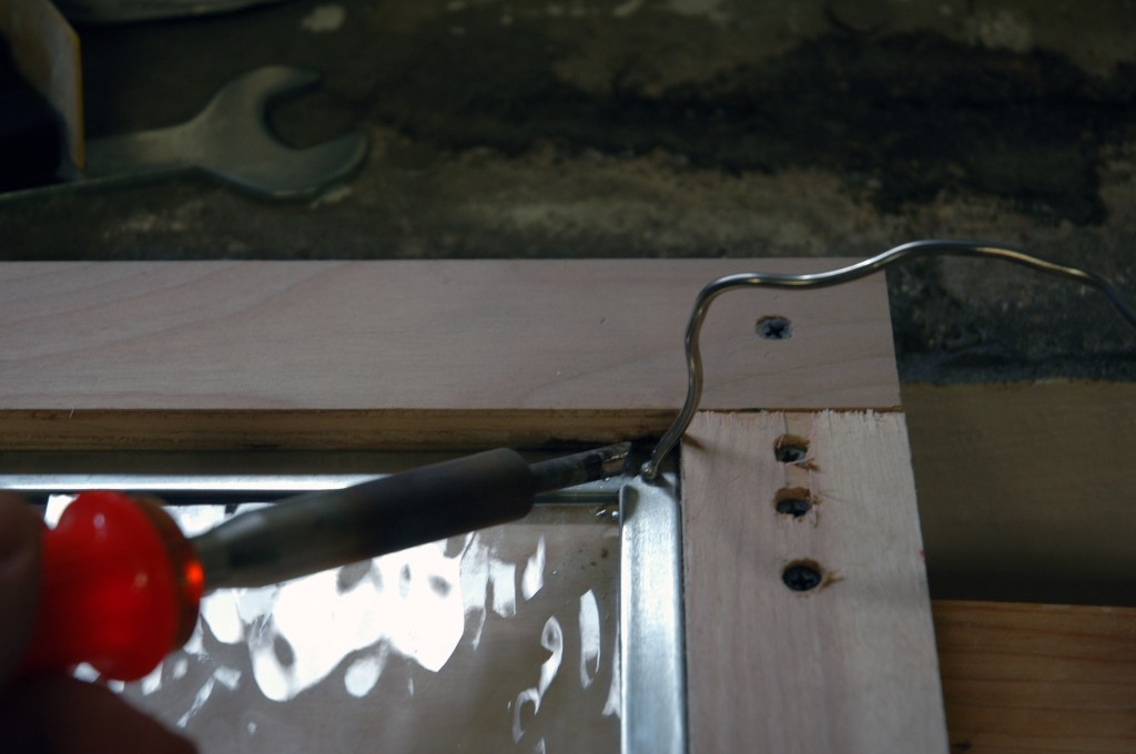 Position the solder over the joint and use the iron to melt it into the joint.