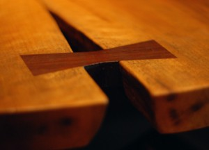 A butterfly key binds a split in a slab table by George Nakashima.
